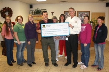 Dr. Brett Bauscher of Canyon Small Animal Hospital accepts his $1000 prize for winning the 3rd quarter of the 2012 My Vet's the Best Contest by Pets Best Insurance.