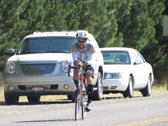 A pet insurance employee bikes in a race.