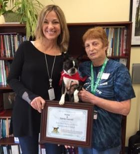 Therapy dog Kona with her handler Sandy Cornell, and fifth grade teacher at Reed Intermediate School, Karen King.