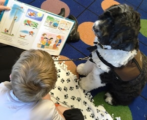 2016 Books & Barks contest finalists, Brinkley, and the students he reads to at local schools and libraries in Oregon.