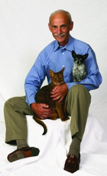 Dr. Jack Stephens, the founder of US pet health insurance, sits with his pets.