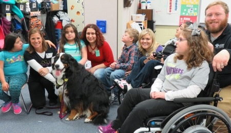 The Books & Barks contest winner of 2015, Ellie Rose, a Bernese mountain dog, and the students she reads to at Peterson Elementary in Naperville, Illinois.