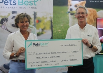 Pets Best president, Chris L. Middleton (right), presents to Dr. Pam Nichols (left), the 2015 grand prize winner of the company's nationwide My Vet's the Best contest.