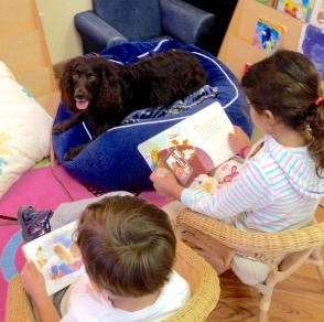 2016 Books & Barks contest finalist, Tess, and the children she reads to in the Caring Canines Program of the 15th Circuit in Palm Beach, Florida.