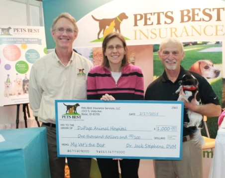 Dr. Mary Felt accepts her award from Pets Best at the Western Veterinary Conference in Las Vegas, Nevada.
