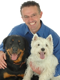 Pet insurance enthusiast Liam Crowe poses for a photo with his pets.