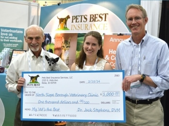 Dr. Sarah Coburn, center, receives $1,000 for the treatment of animals in need from Dr. Jack Stephens,  left, president and founder of Pets Best Insurance Services, LLC, and Chris Middleton, chief operating officer of Pets Best. Pets Best named Dr. Coburn the grand prize winner of its 2013 My Vet's the Best contest on Feb. 18 at the Western Veterinary Conference in Las Vegas.
