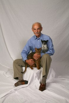 Dr. Jack Stephens, the pioneer of pet insurance in the U.S., sits with his pets.